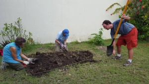 Rev. Chris and Amanda working on the garden at FSIL.